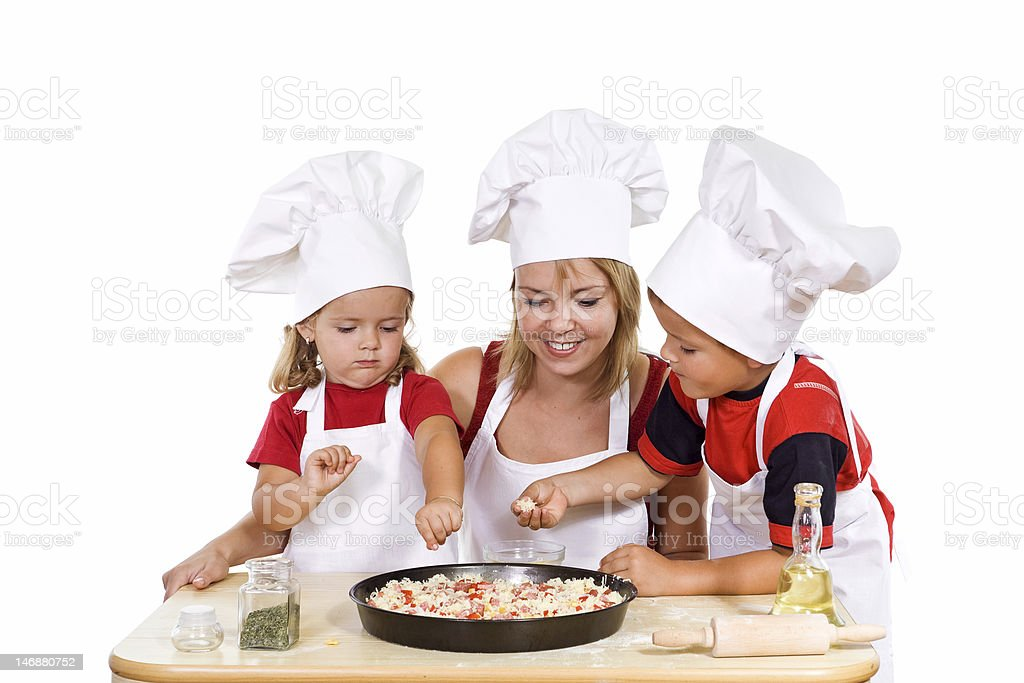 Kids and their mother preparing a pizza royalty-free stock photo