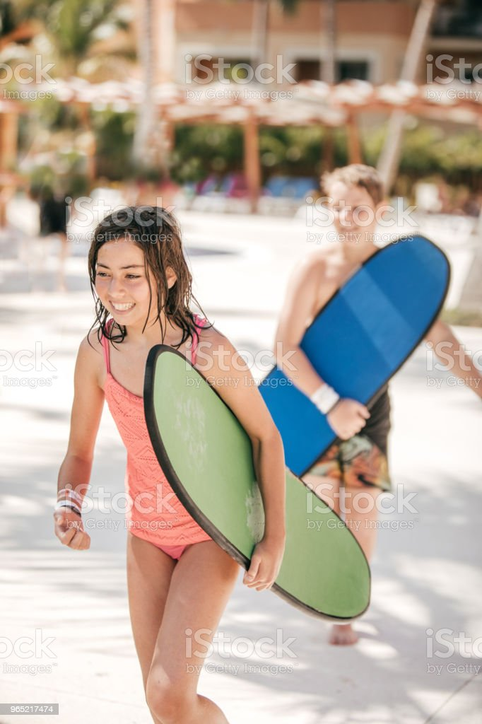 Kids and their surfing boards royalty-free stock photo