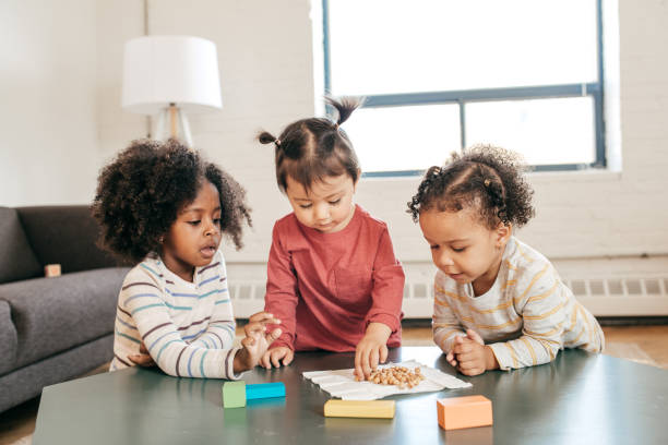 Kids are busy with educational toys stock photo
