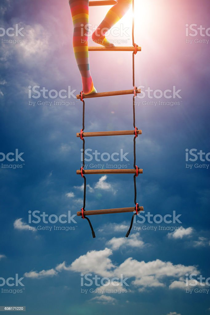 Kids are climbing the stairs to be successful in education stock photo