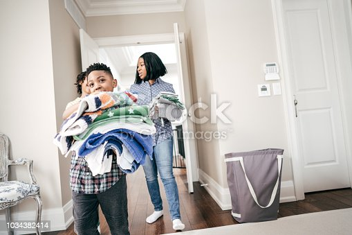 954356678istockphoto Kids are helping mom 1034382414