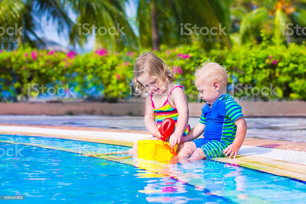 Kids at a swiming pool stock photo