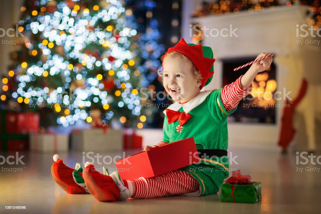 Kids At Christmas Tree Children Open Presents Stock Photo Download Image Now Istock