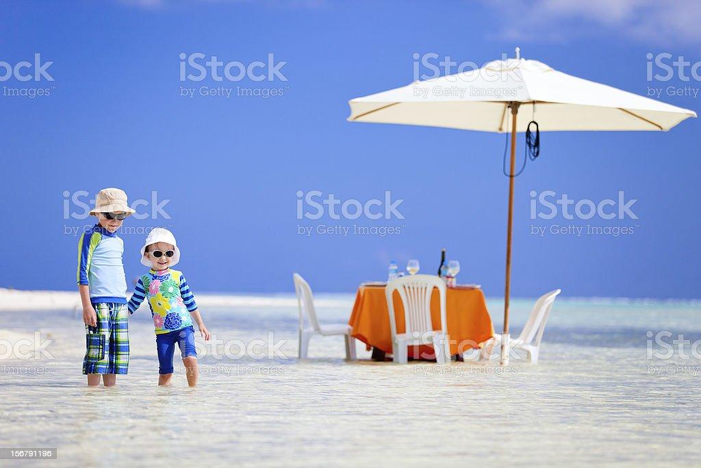 Kids at exotic island picnic royalty-free stock photo
