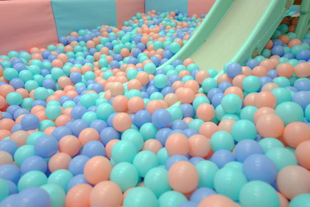 Kids ball pit or ball pool playground with slide for children kids stock photo