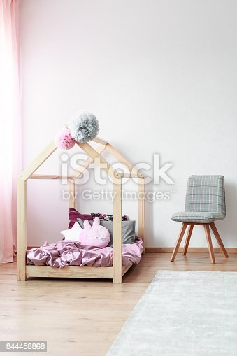 1213866189 istock photo Kids bedroom with grey chair 844458868