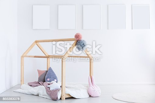 1061427386 istock photo Kid's bedroom with pastel pillows 855383078