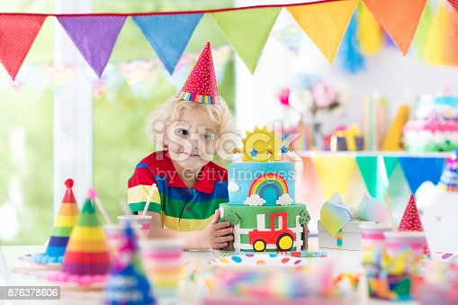 Kids Birthday Party Child Blowing Out Cake Candle Stock Photo More Pictures Of Baby