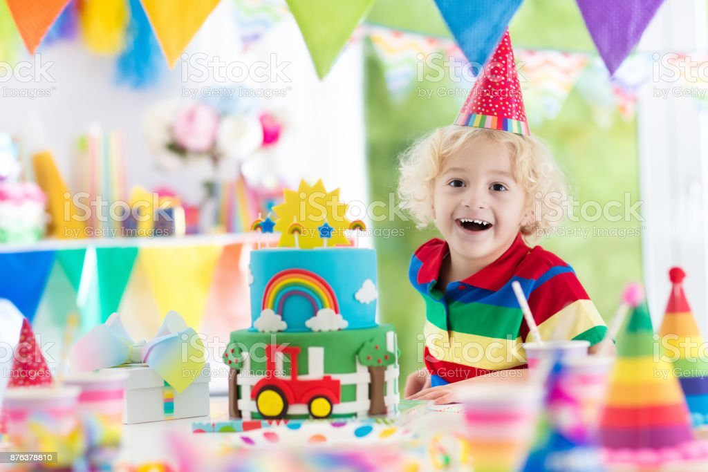 Kids Birthday Party Child Blowing Out Cake Candle Stock Photo Download Image Now Istock