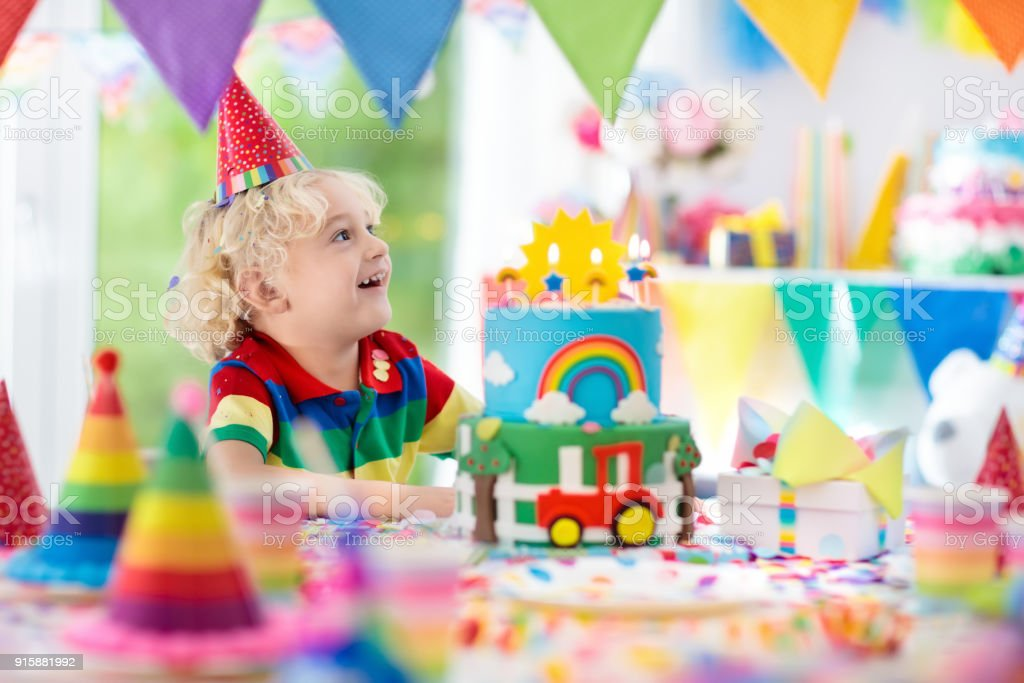 Kids Birthday Party Child Blowing Out Cake Candle Royalty Free Stock Photo