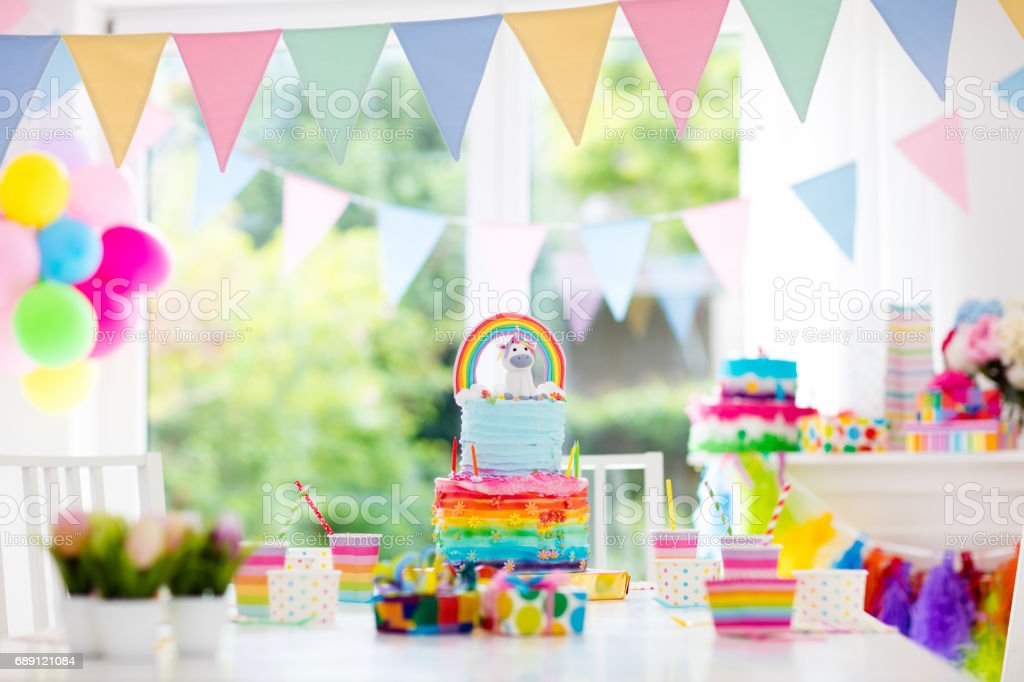 Kids birthday party decoration and cake stock photo