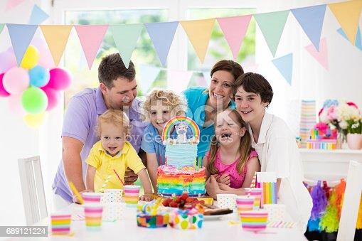 istock Kids birthday party. Family celebration with cake. 689121224