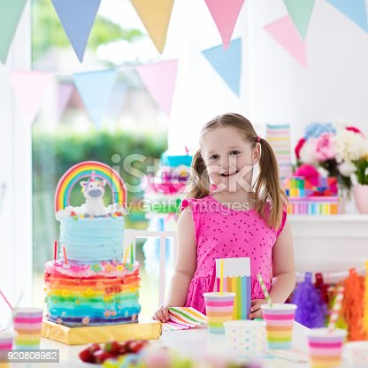 istock Kids birthday party. Little girl with cake. 920808982