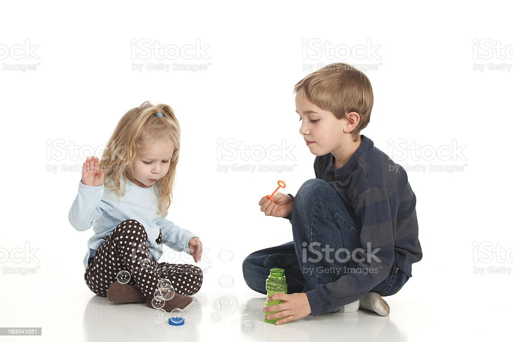 Kids Blowing bubbles, stock photo