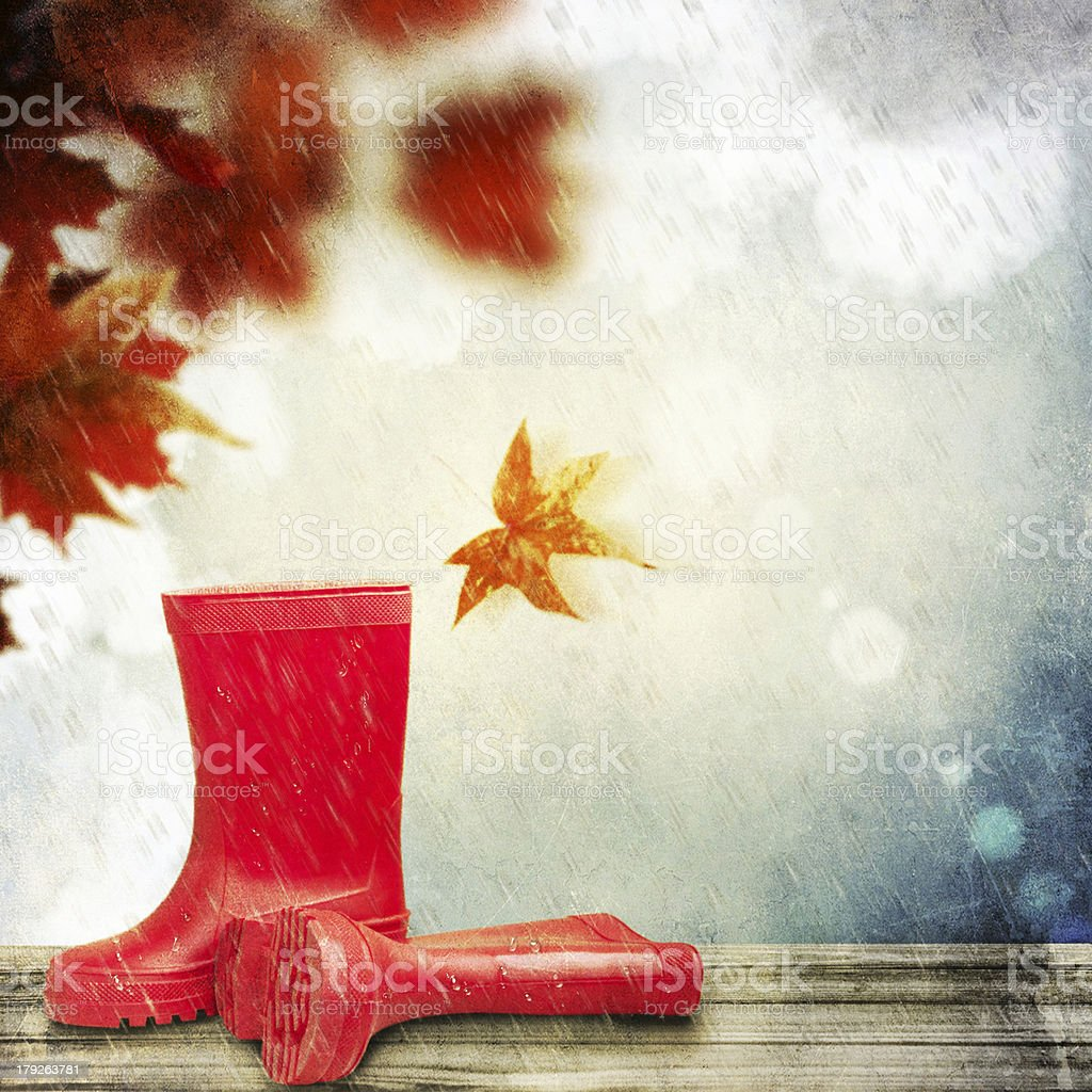 Kids boots on the wooden terrace royalty-free stock photo