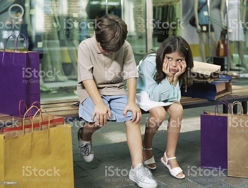 Kids bored with shopping royalty-free stock photo
