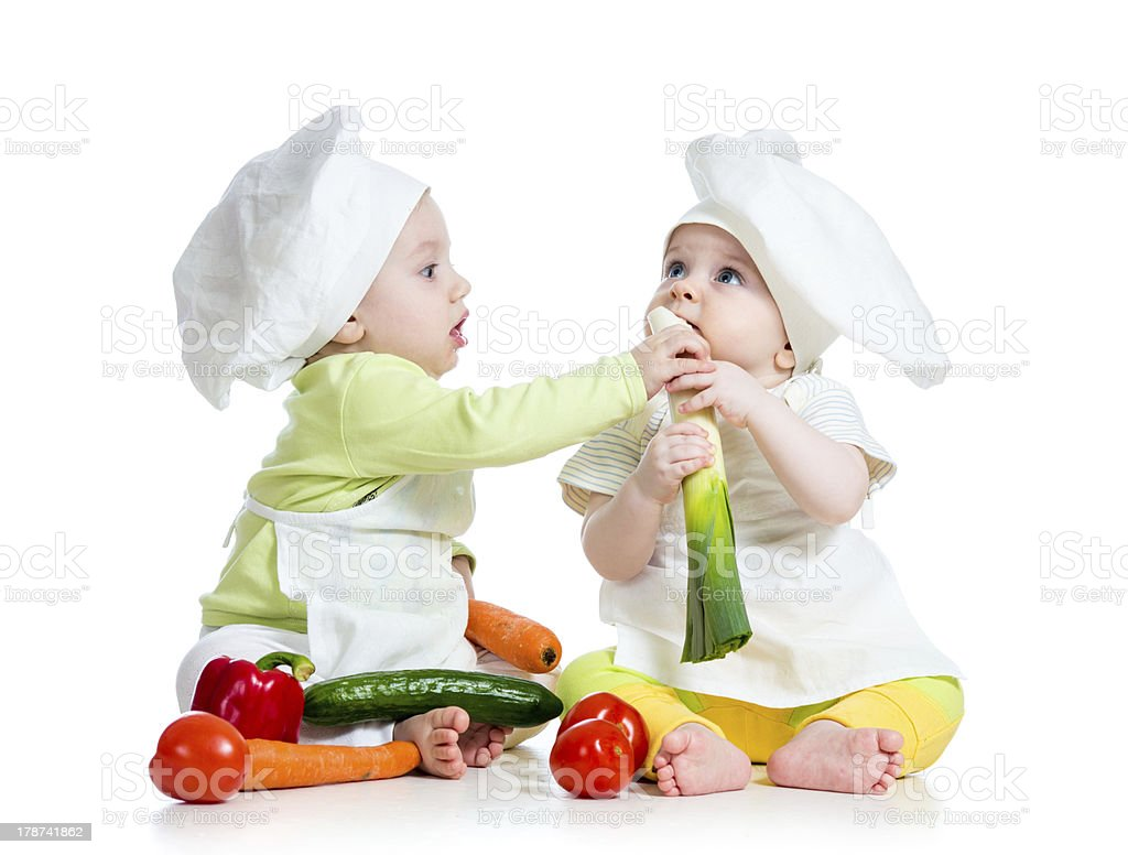 kids boy and girl eat healthy  food vegetables stock photo