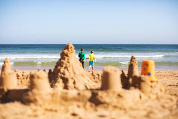 Kids building sand castle stock photo