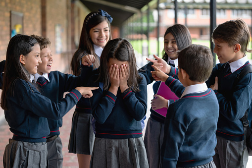Kids Bullying A Girl At The School Stock Photo - Download Image Now - iStock