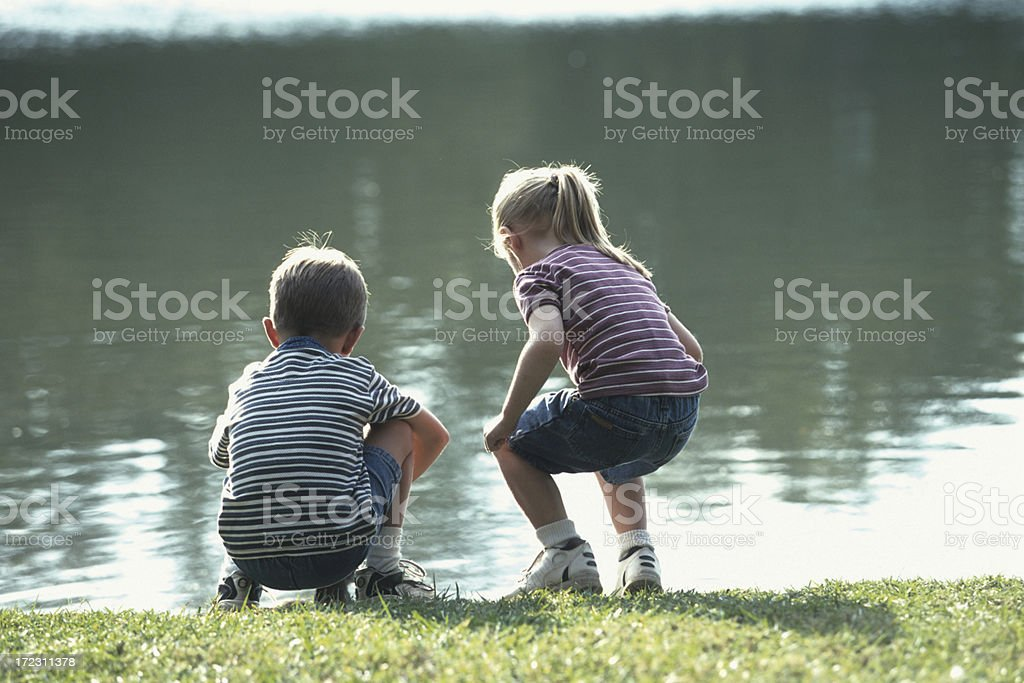 kids by the pond royalty-free stock photo