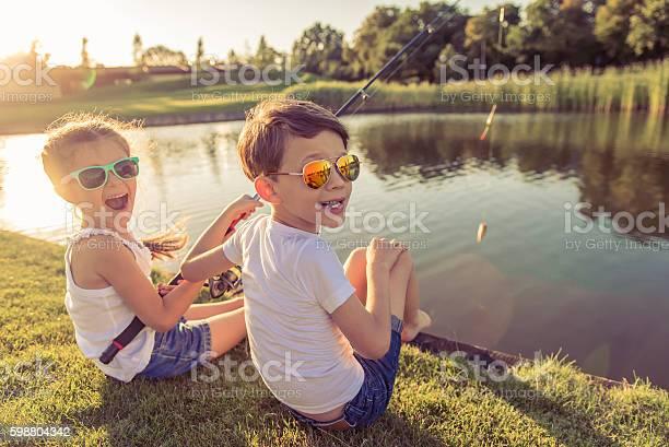 Photo of Kids catching fish