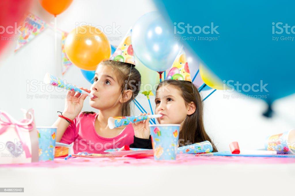 Kids celebrating birthday party stock photo
