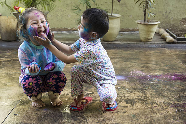 Kids Celebrating Holi Festival of Colors stock photo
