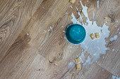 Soggy cereal and milk spilled onto waterproof luxury vinyl hardwood floor