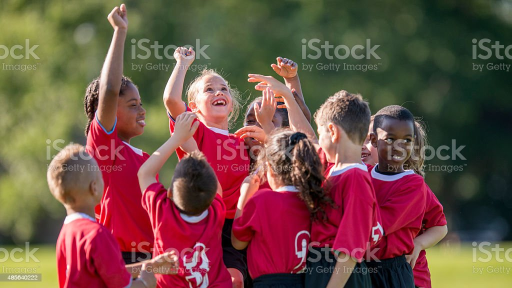 Kids Cheering a Soccer Win stock photo