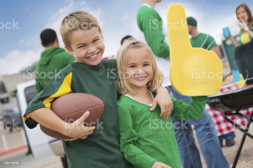 Kids cheering sports team during college football stadium tailgate party stock photo