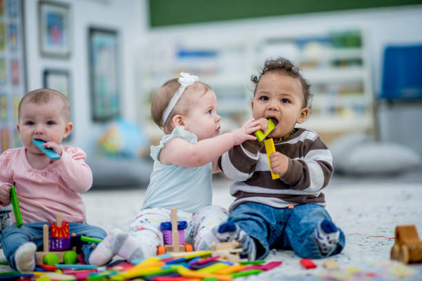 Kids Chewing On Toys stock photo