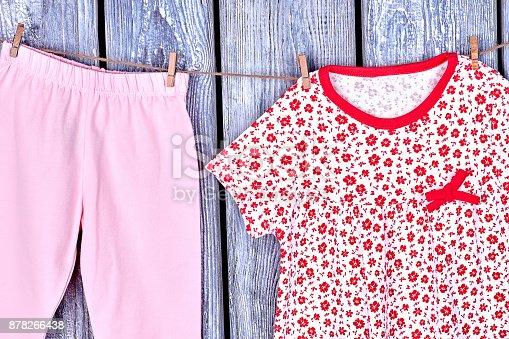 istock Kids clean apparel on clothesline. 878266438