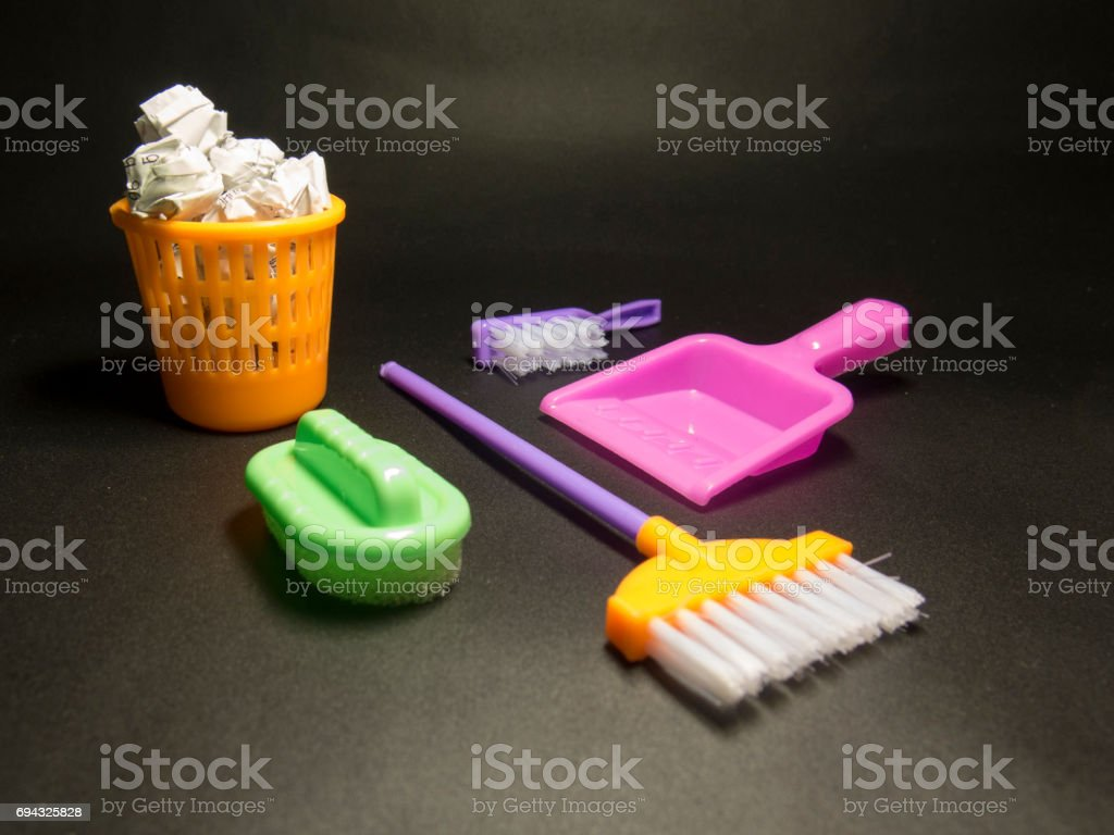 Kids cleaning set with color brushes, bucket and sponges stock photo