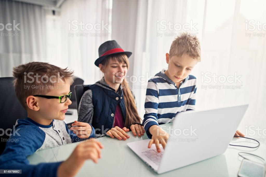 Kids coding at home stock photo