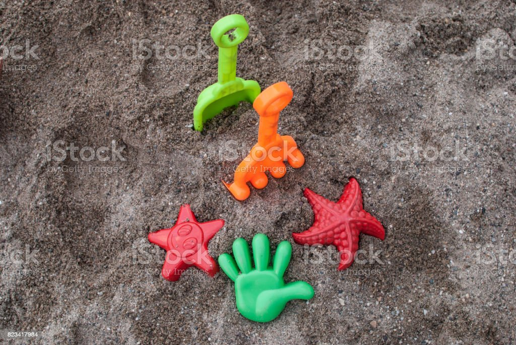 Kids colorful sand on the beach stock photo