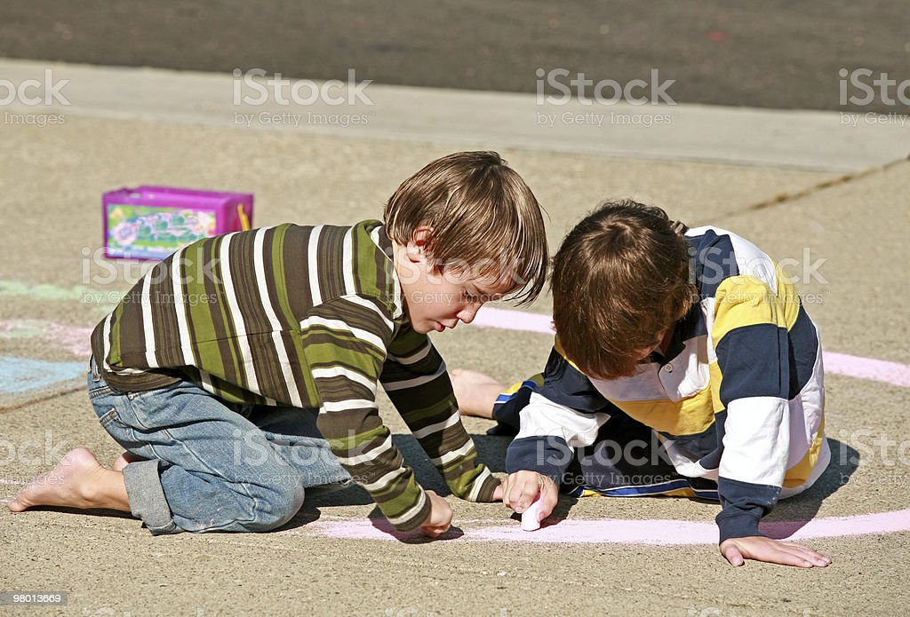Kids Coloring with Chalk royalty-free stock photo