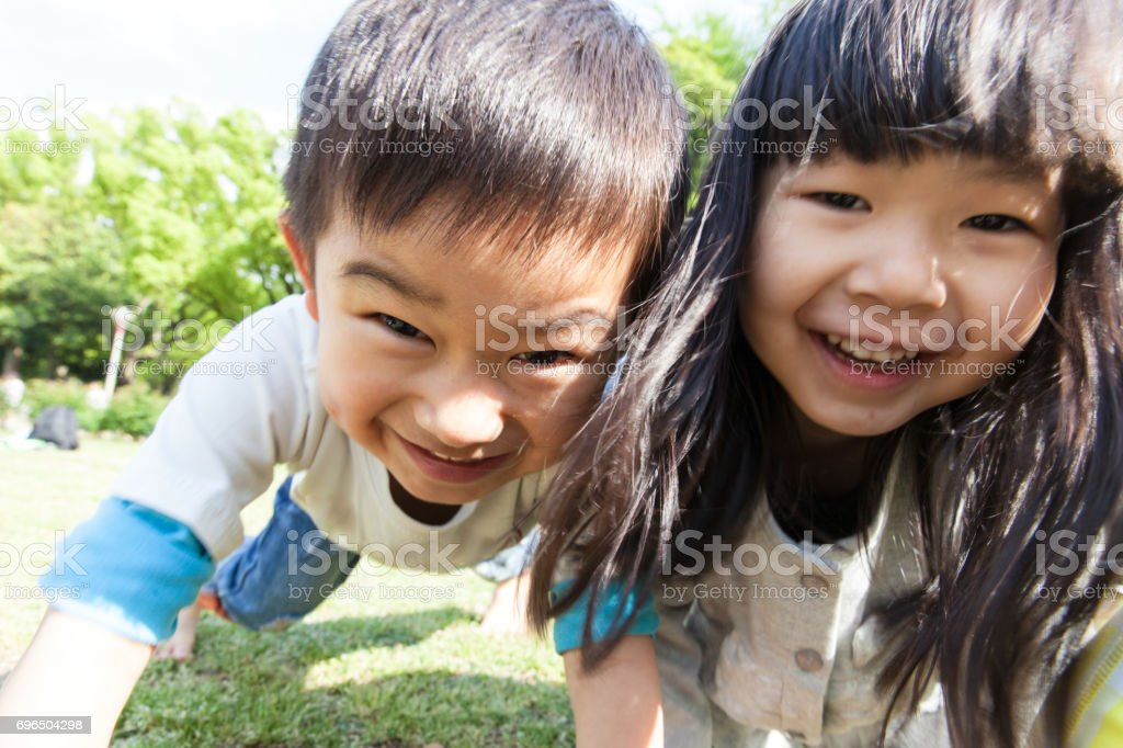 Kids crawling around on all fours stock photo