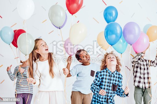istock Kids dancing with balloons 656141880