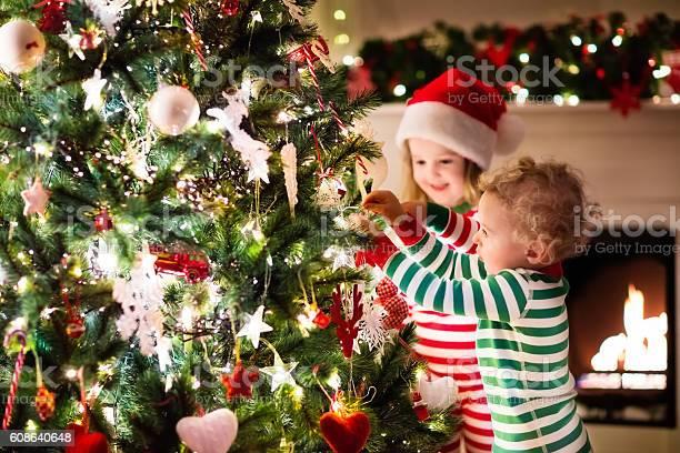 Kids decorating christmas tree in beautiful living room picture id608640648?b=1&k=6&m=608640648&s=612x612&h= j5vtxhok nc1mmtumhosquk74ox0hodqleoufuxyhi=