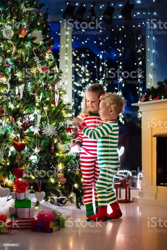 kids decorating christmas tree royalty free stock photo - Kids Decorating For Christmas