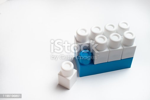 544818734 istock photo Kids development, Building blocks and construction. White and blue color blocks. 1199196851