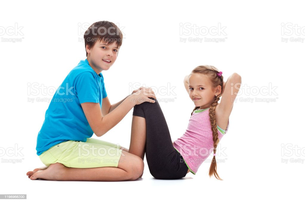Kids Doing Gymnastic Exercises Helping Each Other Stock Photo Download Image Now Istock