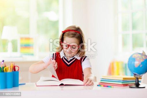 istock Kids doing homework. Children go back to school. 1165010065