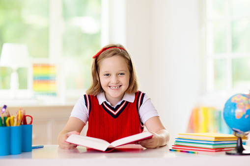 istock Kids doing homework. Children go back to school. 1165011005