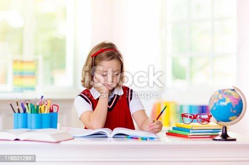 istock Kids doing homework. Children go back to school. 1165012991