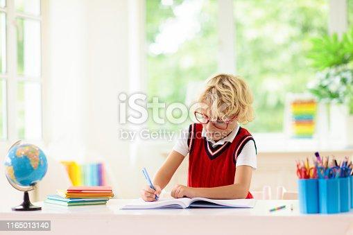 istock Kids doing homework. Children go back to school. 1165013140