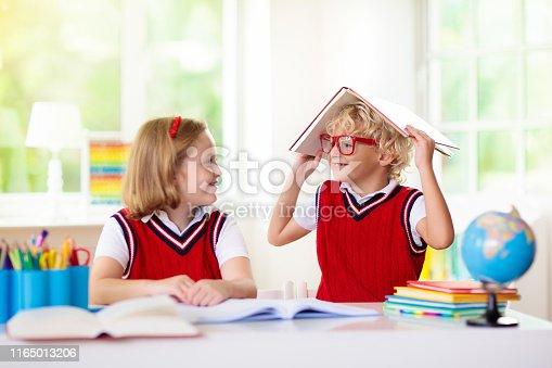 istock Kids doing homework. Children go back to school. 1165013206