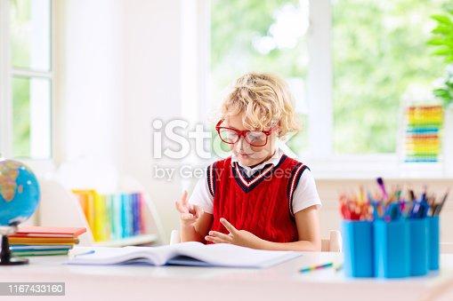 istock Kids doing homework. Children go back to school. 1167433160