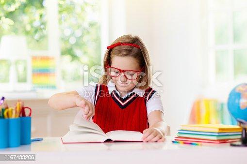 istock Kids doing homework. Children go back to school. 1167433206