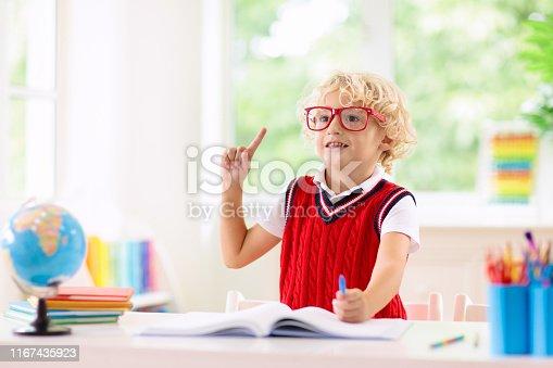istock Kids doing homework. Children go back to school. 1167435923